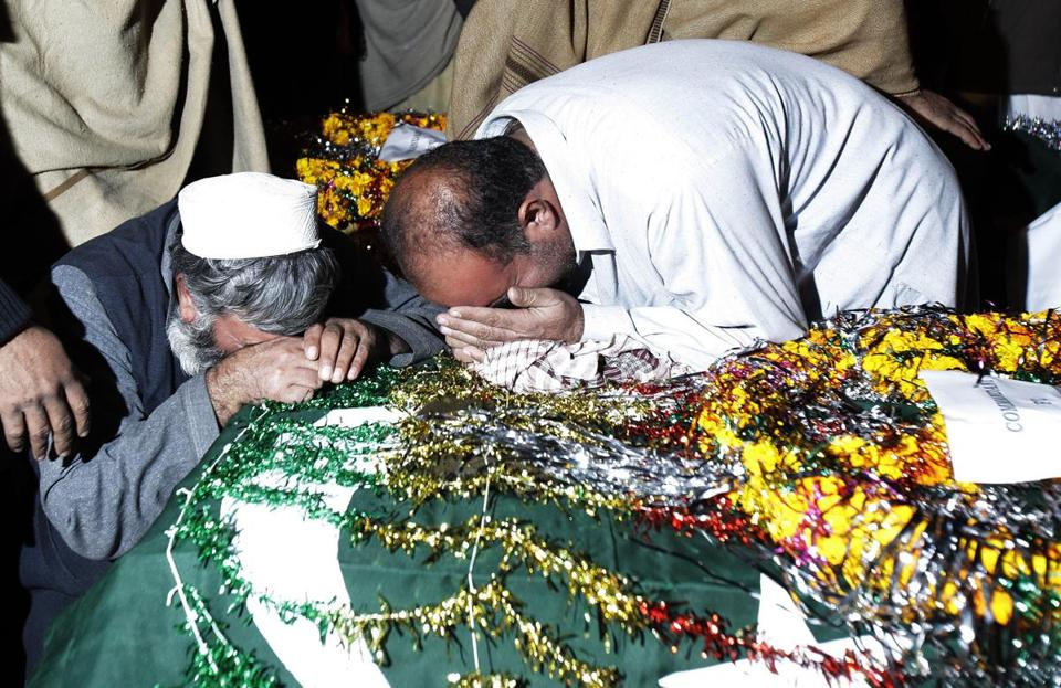A family member was mourned yesterday in Peshawar after militants killed 15 security force members seized last month.