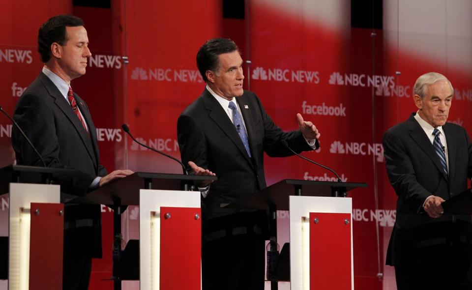 Mitt Romney made a point during this morning's GOP debate in Concord, N.H., as Rick Santorum, left, and Ron Paul listened. Also participating were Newt Gingrich and Jon Huntsman. The debate was the last before the New Hampshire primary Tuesday.