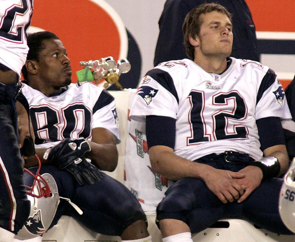 Troy Brown, left, and Tom Brady saw their two-year run as NFL champions end.