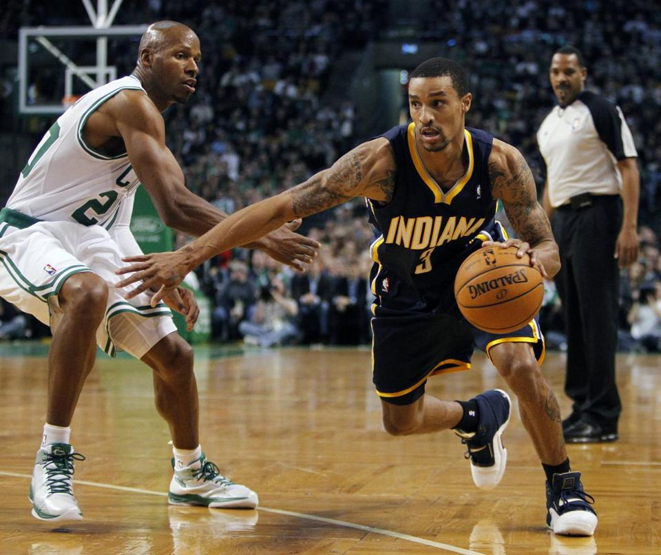 The Pacers' George Hill drove past Ray Allen in the first quarter.