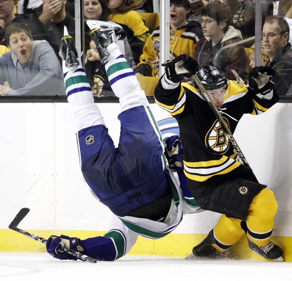 "Brad Marchand's hit was deemed neither defensive nor instinctive, but rather a ""predatory low-hit'' by a repeat offender resulting in a concussion to Canucks defenseman Sami Salo."