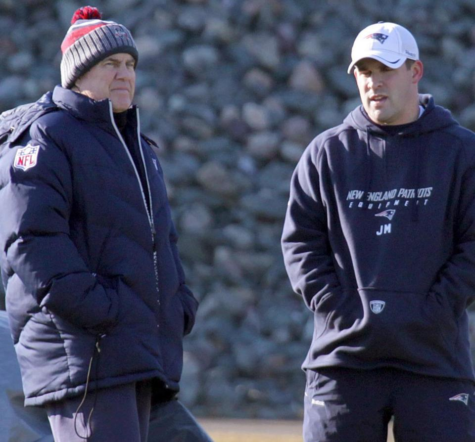 Bill Belichick chats with the recently returned Josh McDaniels, currently an offensive assistant, at practice.