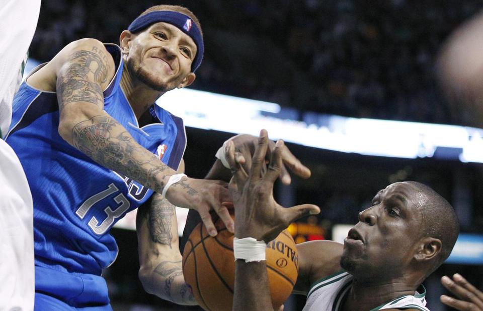 Delonte West, left, was back in the Garden last night with Dallas.