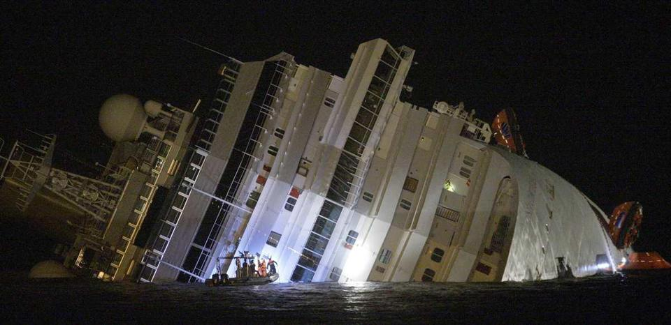 Passengers leapt into the sea and fought over lifejackets in panic when an Italian cruise ship ran aground and keeled over, killing at least three and leaving dozens missing.