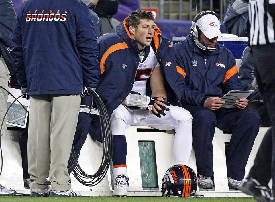 Tim Tebow sat on the bench during the fourth quarter of Saturday's game.