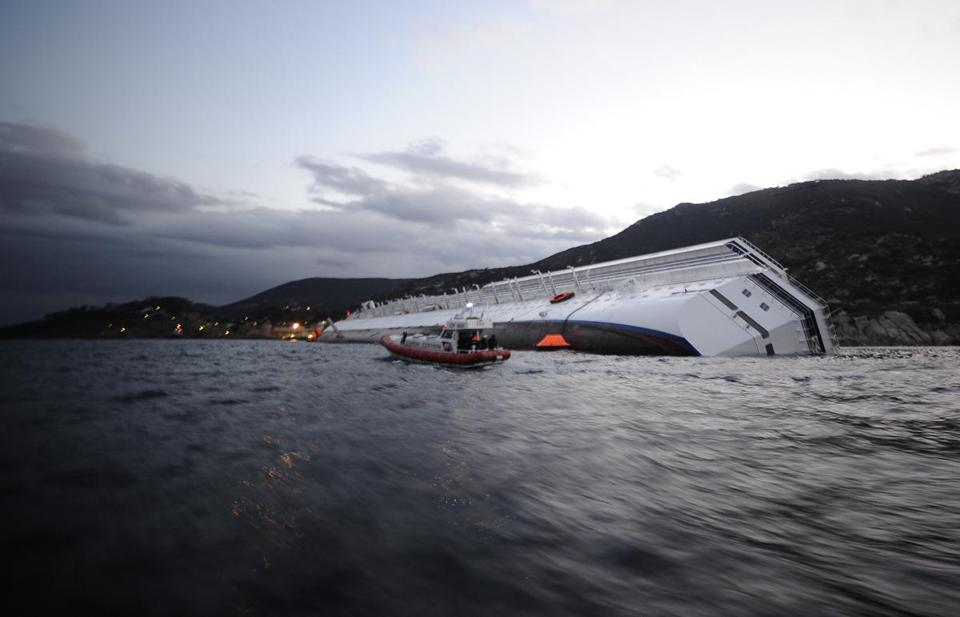 The Costa Concordia cruise ship lay on its side today off the Tuscan island of Giglio.