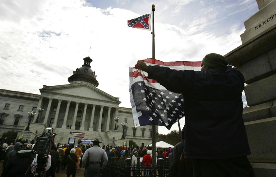 A man protested against the Confederate flag during a rally in South Carolina in January opposing the voter ID law.