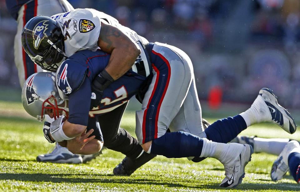 Ravens linebacker Ray Lewis slammed Tom Brady for a sack in the first quarter.