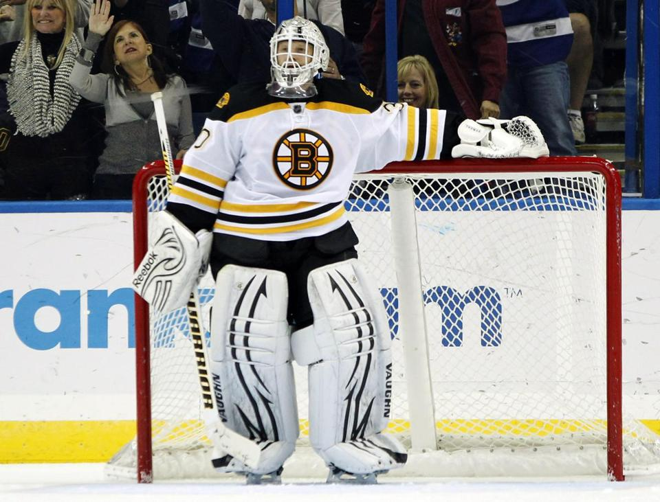 Tim Thomas wasn't happy after \giving up the game-winning goal to Lightning center Dominic Moore late in the third period.
