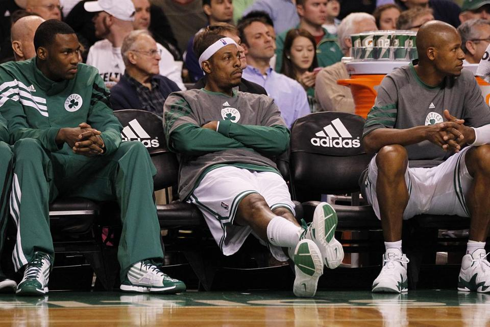 Paul Pierce, center, Ray Allen, right, and the Celtics have won just five of their first 13 games.