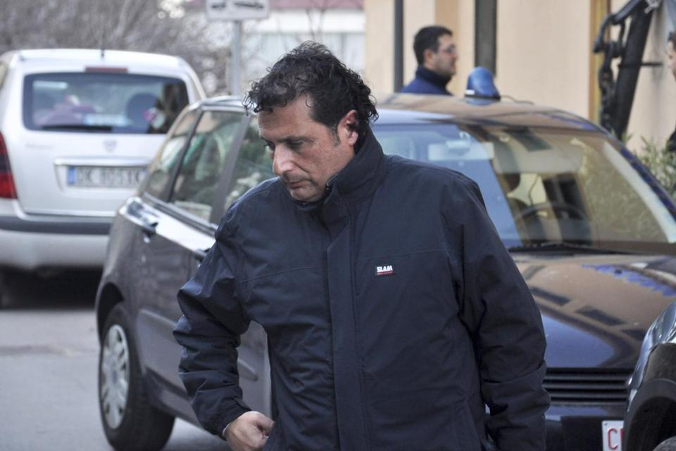In this photo taken on Saturday, Jan. 14, 2012, and made available, Wednesday, Jan. 18, 2012, Francesco Schettino, the captain of the luxury cruiser Costa Concordia, which ran aground off Italy's Tuscan tiny island of Isola del Giglio, is arrested in Porto Santo Stefano, Italy. Schettino, released on Tuesday, and currently under house arrest in his hometown of Meta di Sorrento, southern Italy, is investigated for manslaughter charges and abandoning the ship. (AP Photo/Giacomo Aprili)