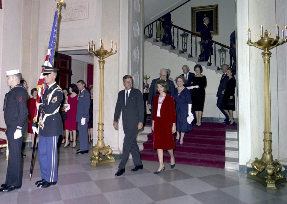 This Nov. 20, 1963 photo released by the John F. Kennedy Presidential Library and Museum in Boston shows President John F. Kennedy and  Jacqueline Kennedy descending the Grand Staircase at the White House.