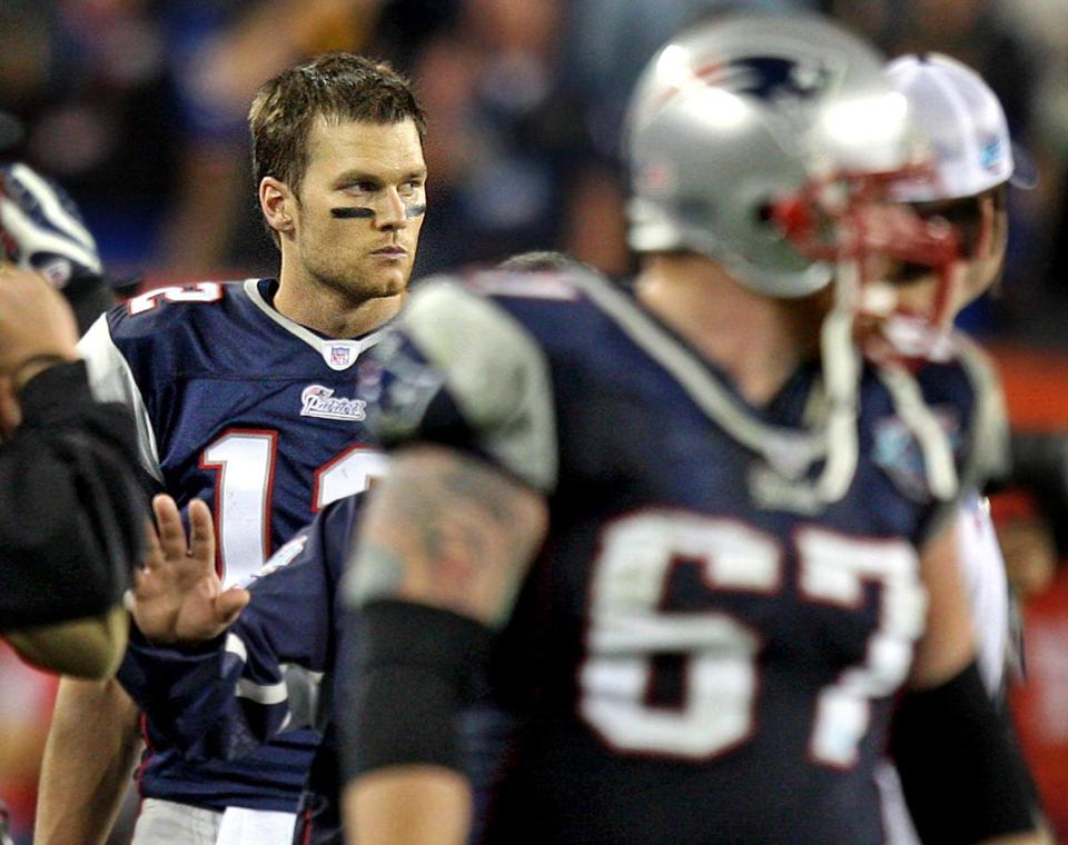 Tom Brady scowled as he watched the Giants begin to celebrate their Super Bowl victory.
