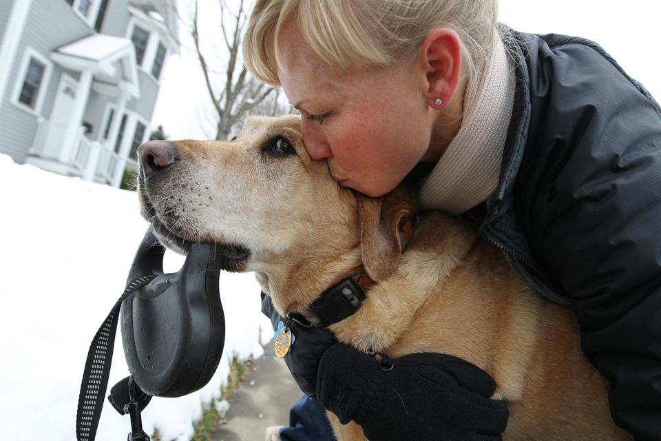 "West Newton, MA 1/23/12 Lindsay Massengale's (cq) 8-year-old yellow Lab ""Kona"" was always active, usually walking from two to three times a day. But without her realizing it, he had swelled to 103 pounds. Lamenting that she had become a bad parent, with help, she changed his diet and he shrunk down to 80 pounds. They take a short 40-minute walk and then play in their front yard, on Monday, January 23, 2012. (Pat Greenhouse/Globe Staff); Reporter: Beth Teitell; Section: Lifestyle; Slug: fat pets"