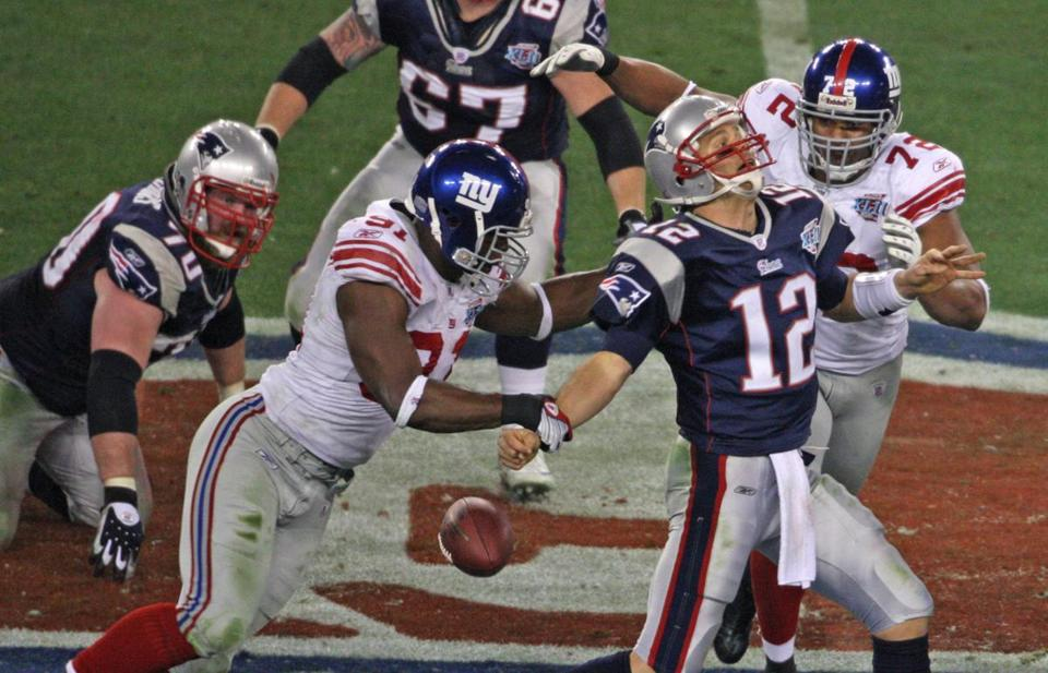 The Giants hit Tom Brady nine times and sacked him five times in Super Bowl XLII.