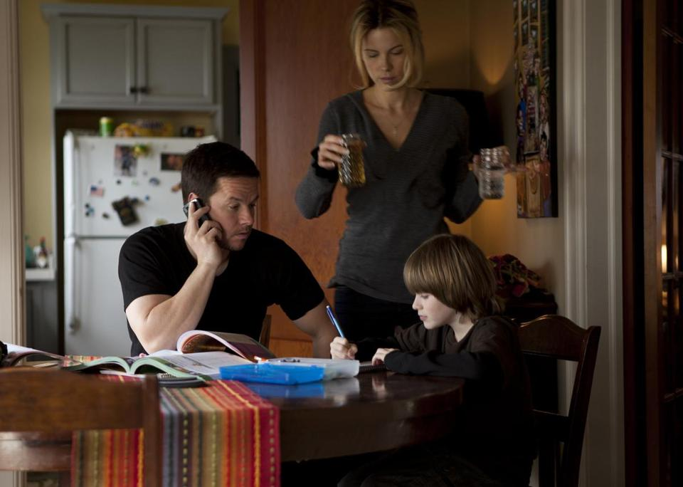 MarkWahlberg (with Kate Beckinsale and Connor Hill) plays an ex-smuggler in ''Contraband.''