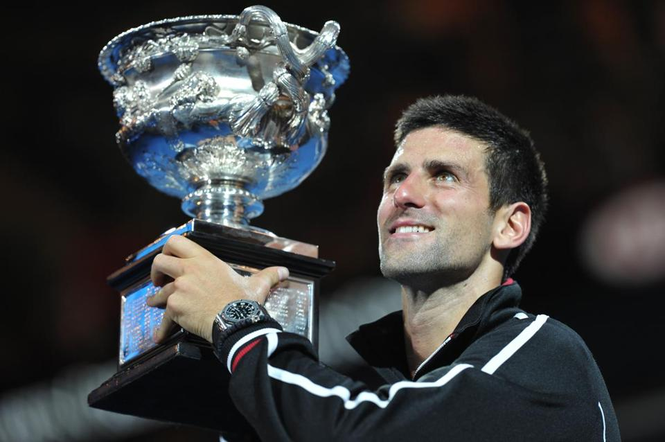 Novak Djokovic of Serbia held the trophy after defeating Rafael Nadal in the Australian Open.