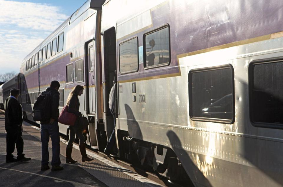 Passengers boarded the commuter rail at the Framingham MBTA stop in this Jan. 28, 2012 file photo.