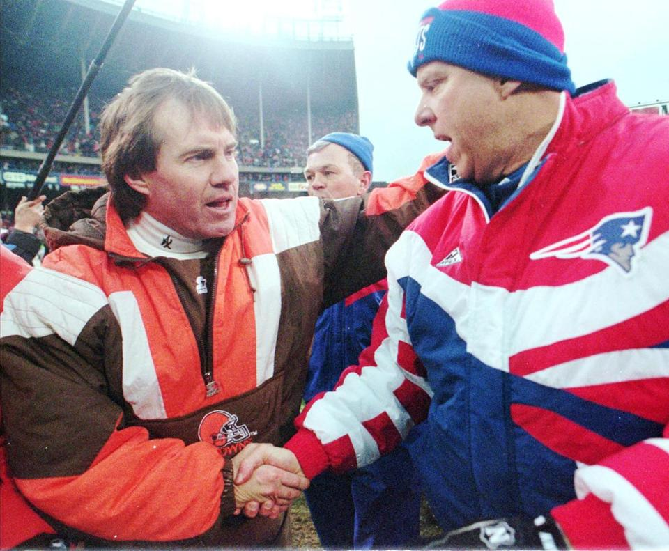 Cleveland Browns coach Bill Belichick, left, shook hands with Patriots coach Bill Parcells after the Browns defeated the Patriots 20-13 to win the AFC wild card game Sunday, Jan. 1, 1995.