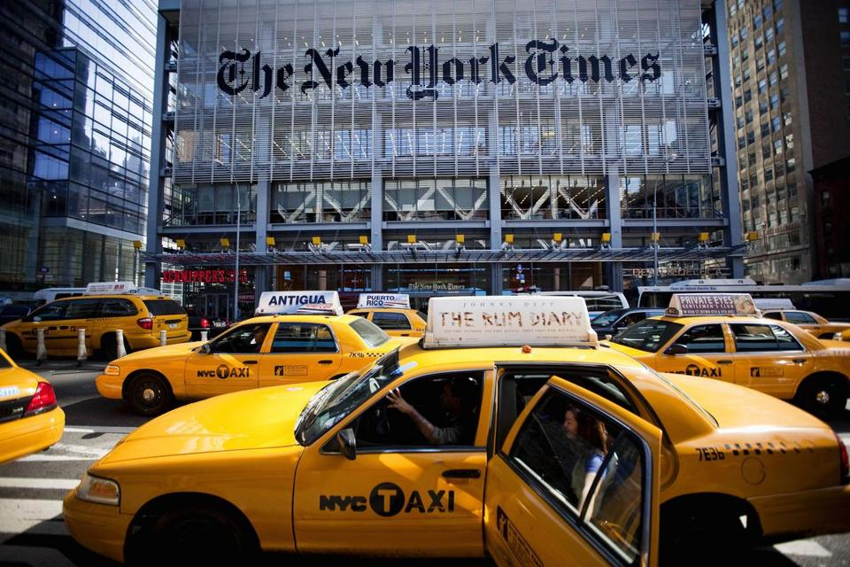 FILE PHOTO / BEST BLOOMBERG PHOTOS FOR 2011: Taxi cabs drive past The New York Times Co. headquarters in New York, U.S., on Tuesday, Oct.18, 2011. The New York Times Co. is scheduled to release quarterly earnings on Oct. 20. Photographer: Michael Nagle/Bloomberg