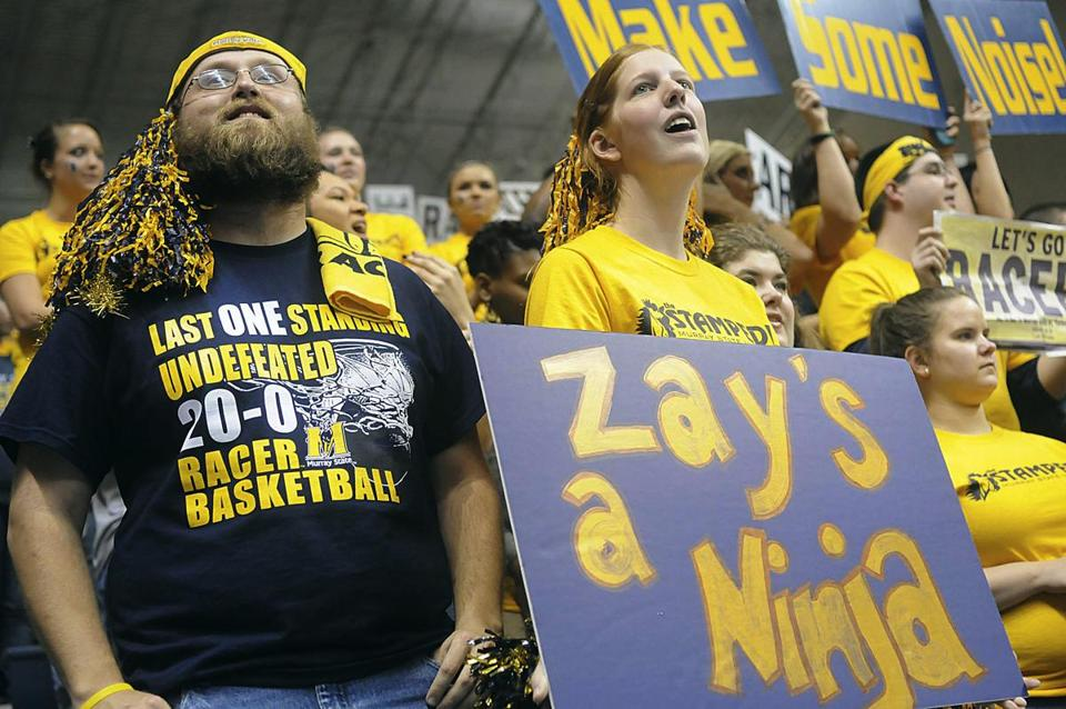 Nick Alexander, a junior student from Murray, Ky., left, cheers with Murray State fans during an NCAA college basketball game against Eastern Illinois, Saturday, Jan. 28, 2012, in Murray, Ky. Murray State won 73-58. (AP Photo/The Paducah Sun, John Wright)