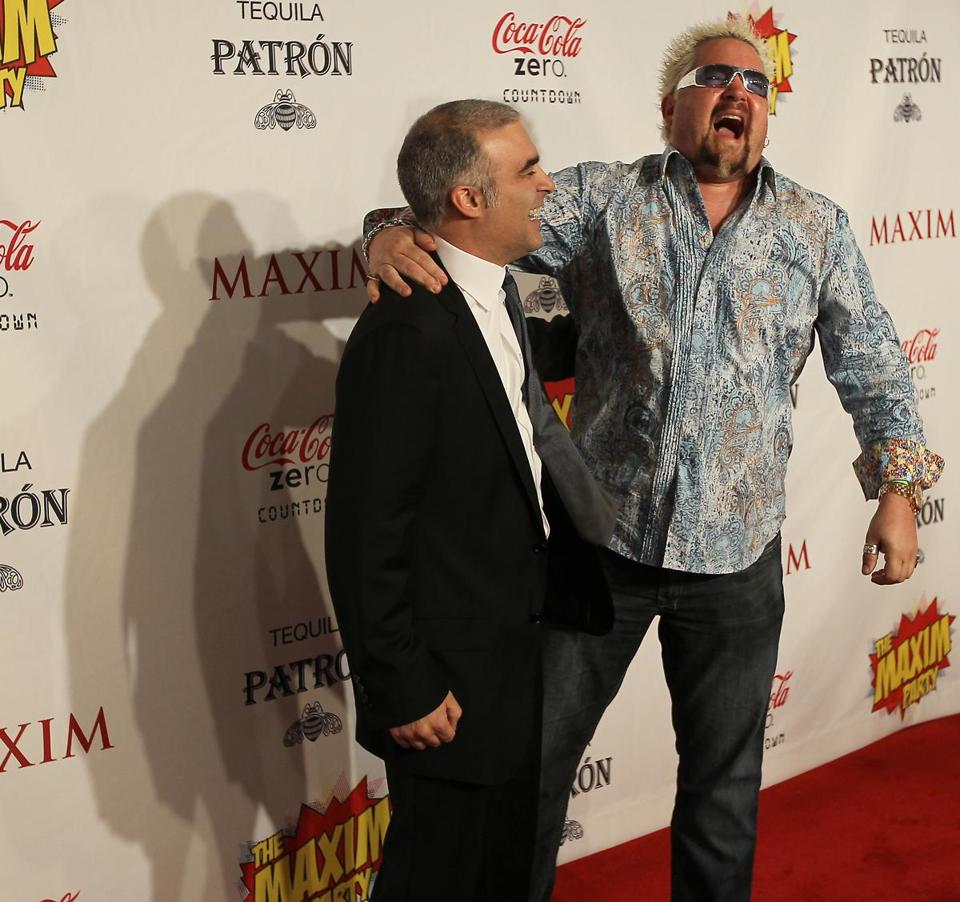 Guy Fieri (right) had a laugh with the editor-in-chief of Maxim magazine, Dan Bova, on the red carpet of the Maxim Superbowl party in February in Indianapolis.