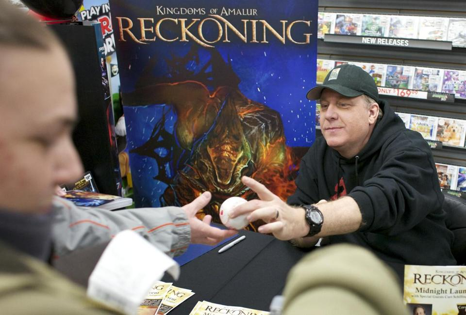 "Curt Schilling met fans at a Bellingham store for the 2012 release of his video game ""Kingdoms of Amalur: Reckoning."""