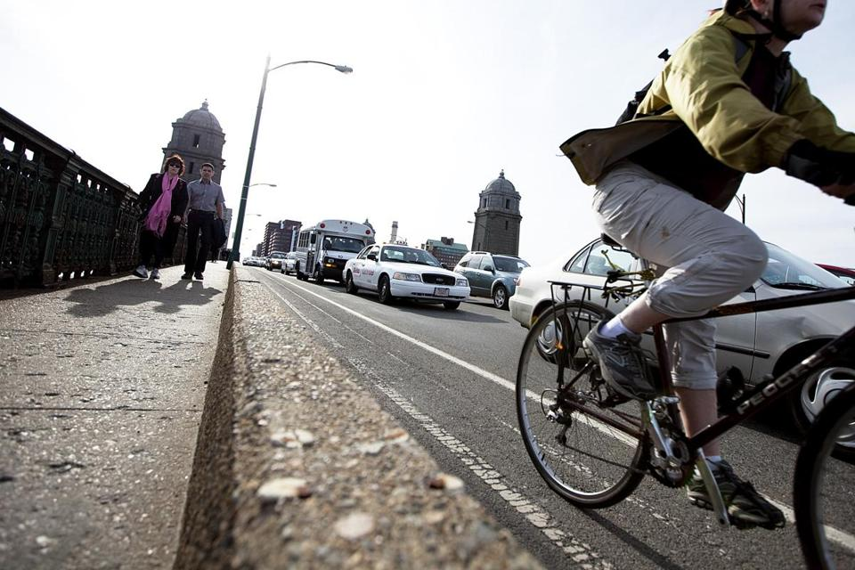 Motorists, pedestrians, and a cyclist all made their way across the Longfellow Bridge.