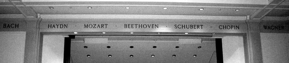 The frieze near the ceiling at Harvard's Paine Concert Hall is etched with names of great composers.