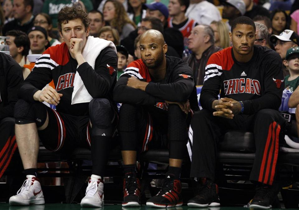 Derrick Rose, right, had to watch yesterday's game from the bench.