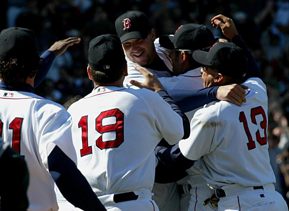 Teammates mobbed Derek Lowe after he threw the Red Sox' first no-hitter at Fenway Park since 1965.