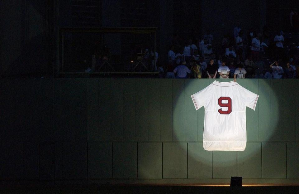A spotlight shined on Williams' jersey along the center field wall during last night's ceremony.