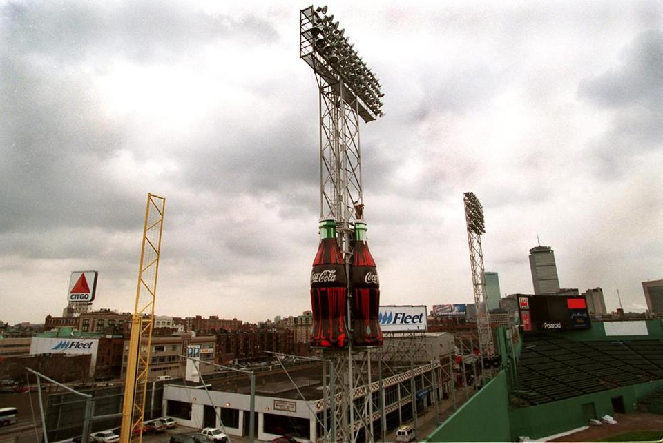 The Red Sox have installed giant Coke bottles that will sit high above the left field wall.