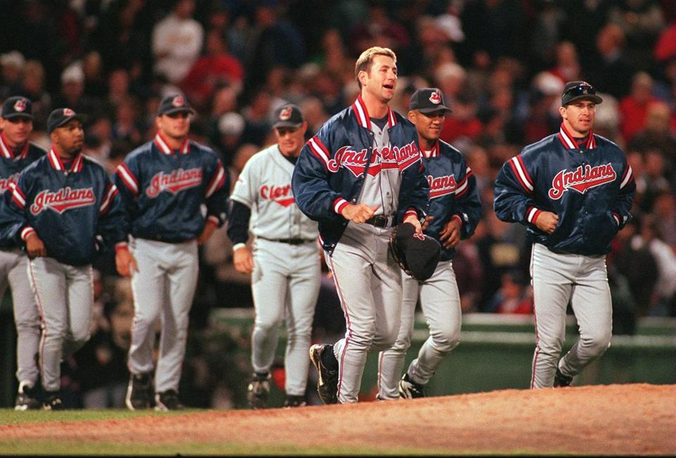 Indians starter Charles Nagy, foreground, led his team out to celebrate the victory.