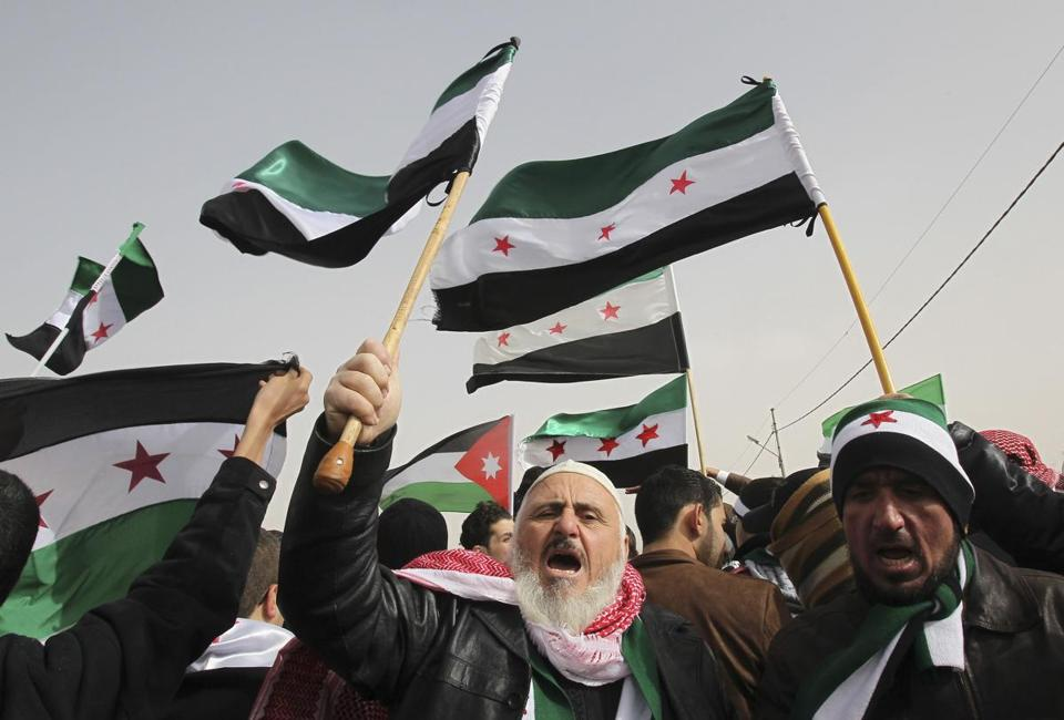 Syrian refugees and residents living in Jordan shouted slogans during a demonstration against Syria's President Bashar al-Assad.