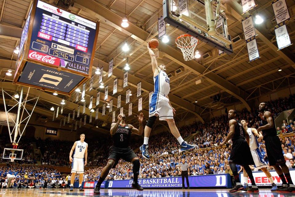 Miles Plumlee #21 of the Duke Blue Devils attempted a dunk against the North Carolina State Wolfpack on Thursday.