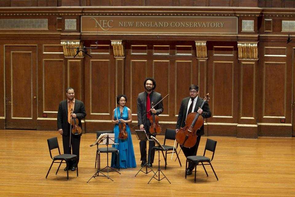 (From left to right) Ilmar Gavilán, Melissa White, Juan Miguel Hernandez, and Paul Wiancko of the Harlem Quartet.