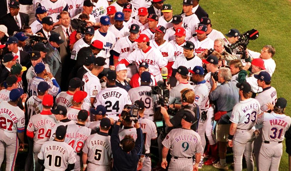 All-Star players gathered around Ted Williams before last night's game.