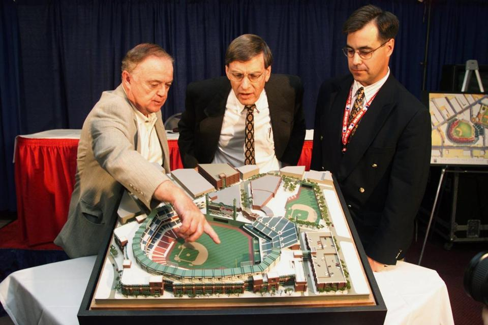 Red Sox CEO John Harrington, left, and GM Dan Duquette showed a replica of the new Fenway Park to MLB commissioner Bud Selig.
