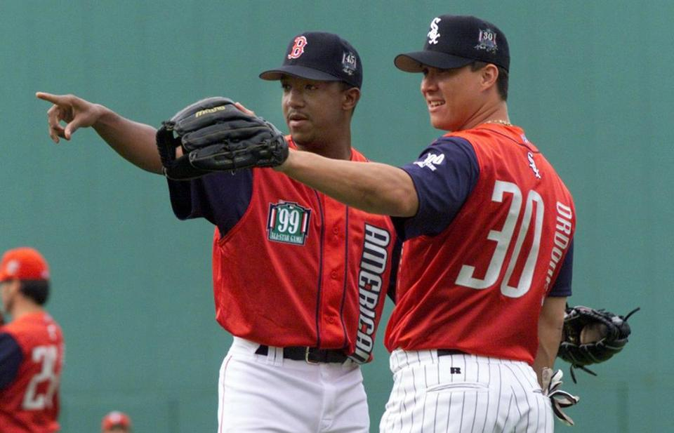 Red Sox pitcher Pedro Martinez, left, talked to White Sox outfielder Maggio Ordonez during practice before the home run derby.