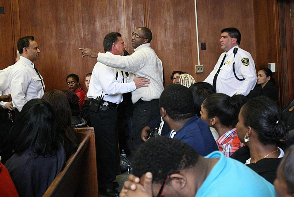 An unidentified man was removed from the courtroom after calling witness Kimani Washington a rat and a snitch.