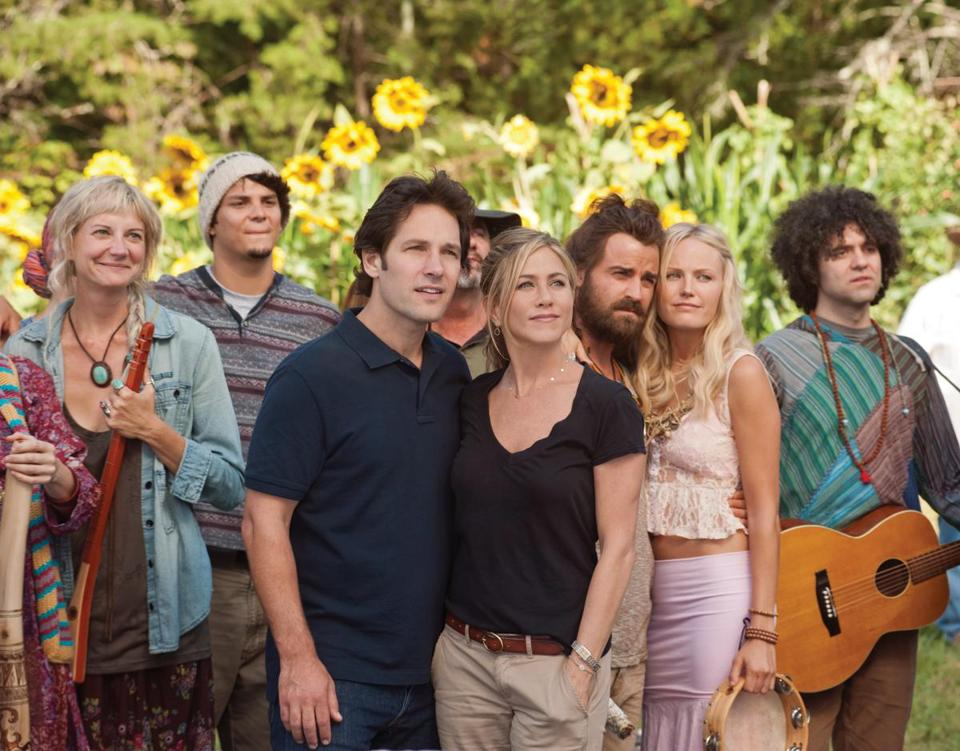 "Paul Rudd and Jennifer Aniston (center) star in ""Wanderlust'' as a couple who move to a hippie commune after losing their jobs."