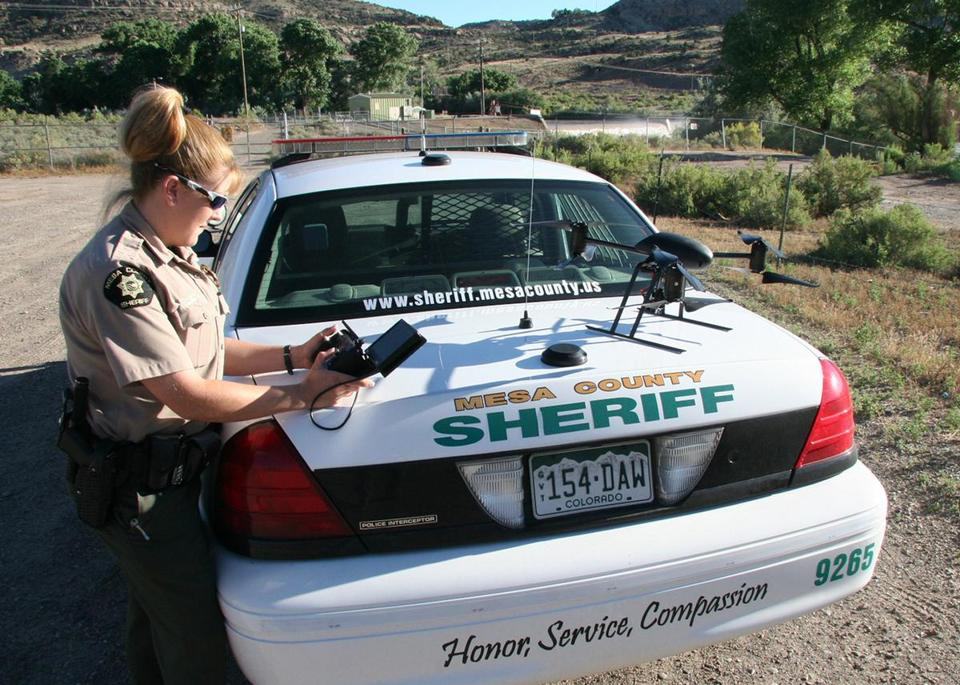 Sheriff's Deputy Amanda Hill prepared to use a Draganflyer X6 camera drone to help search for a suspect in Colorado.