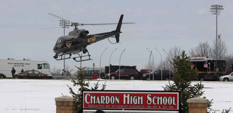 An Ohio State Highway patrol helicopter leaves Chardon High School Monday, Feb. 27, 2012, in Chardon, Ohio. A gunman opened fire inside the high school's cafeteria at the start of the school day Monday, wounding five students, according to officials and local hospitals. A suspect is in custody. (AP Photo/Tony Dejak)