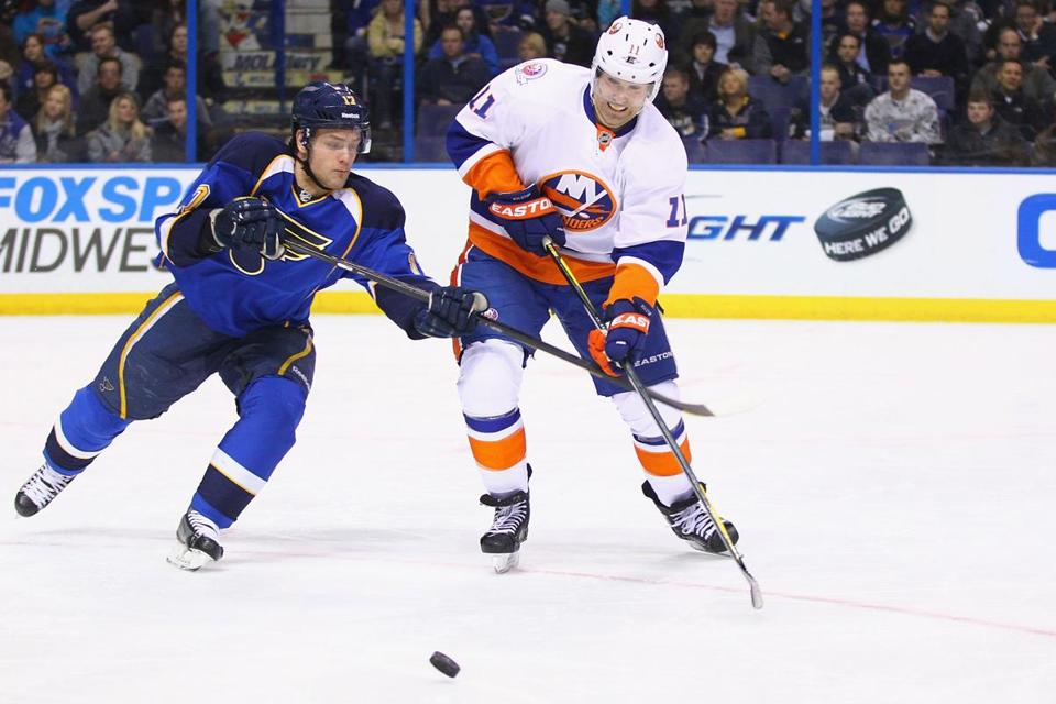 Brian Rolston (right) chased the puck for the Islanders in a game against the St. Louis Blues earlier this month.