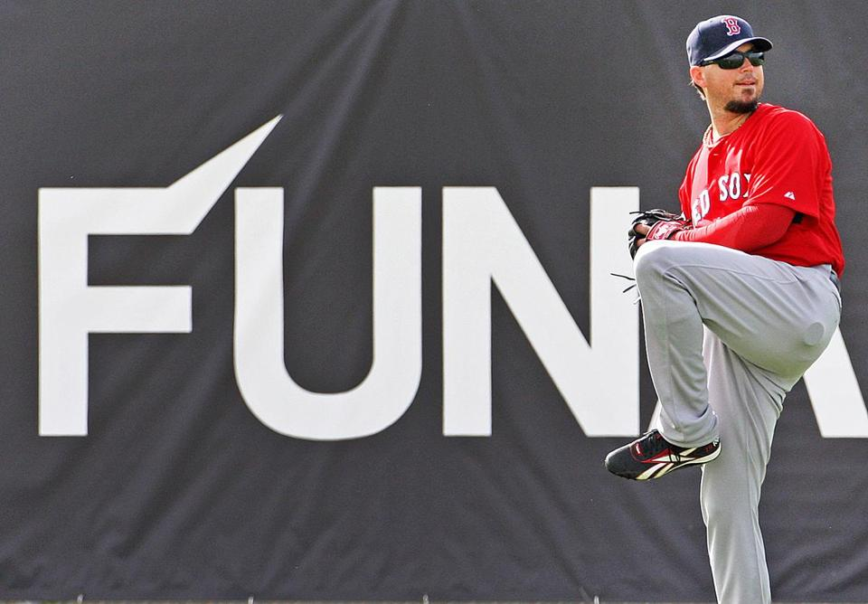 02-27-12: Fort Myers, FL: Don't know how much fun he was having, but Red Sox pitcher Josh Beckett was throwing long toss in the outfield today. (Globe Staff Photo/Jim Davis) section:sports topic:spring training