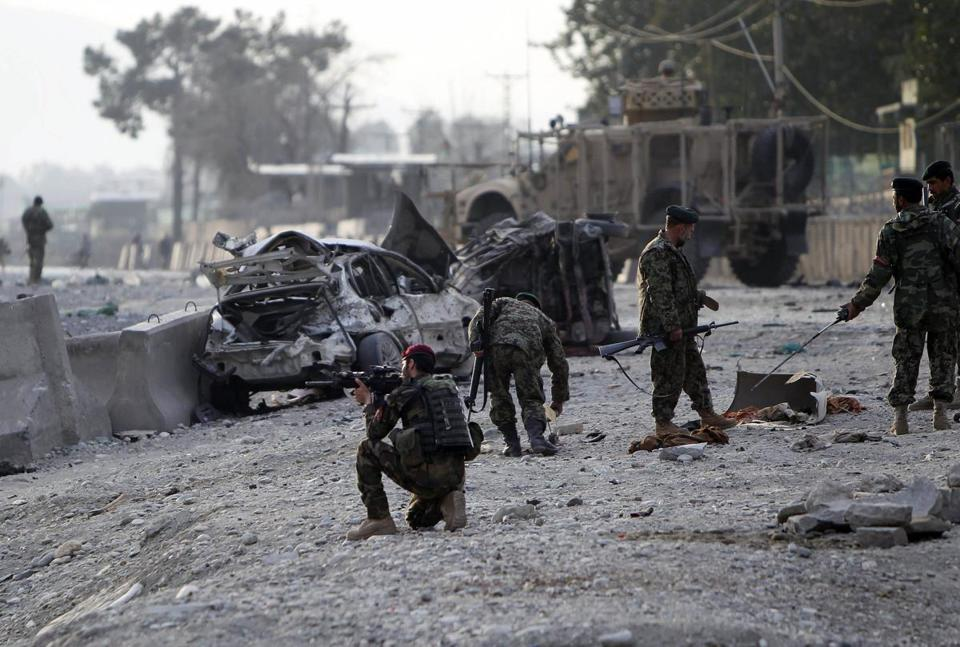 Soldiers inspected the site of a car bomb attack that killed nine near a NATO base in Jalalabad yesterday. Protests in Afghanistan over the past week, in response to US troops' burning of copies of the Koran, have been linked to about 40 deaths. Yesterday, the UN evacuated its international staff from Kunduz.