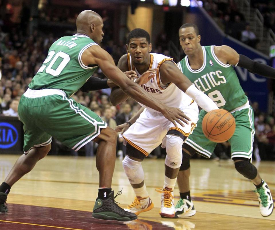 The Celtics' Ray Allen and Rajon Rondo put pressure on the Cavaliers' Kyrie Irving in the second quarter.