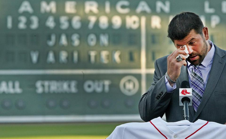Retiring Red Sox captain Jason Varitek wipes away tears while speaking at home plate during a ceremony at JetBlue Park.