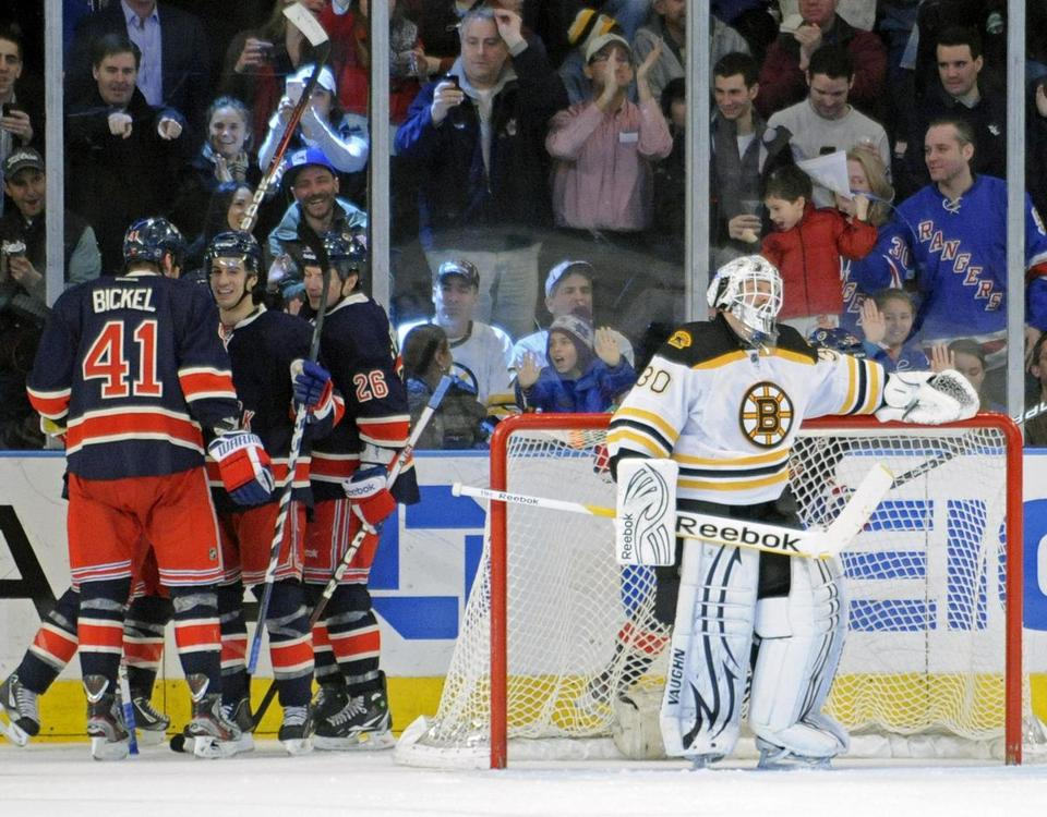 Bruins goalie Tim Thomas chooses not to watch the Rangers celebrate Derek Stepan's deciding goal in the third period.